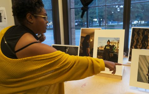 Loren Toney, 2019 photography graduate from Columbia, sets up her prints before the event starts Sept. 9.