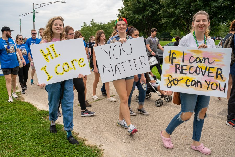 (From left to right) Abby Nelson, a sophmore English major, walks alongside Isabella Youmans, a sophmore cimena and television major, and Katelynne Fulford, a sophmore graphic design major, at the Out of the Darkness Walk at Montrose Beach Sept. 21.