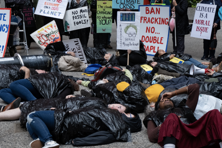 Strikers wore black and layed on the ground to portray oil leaking from The Dakota Access Pipeline at a Sept. 27 protest.