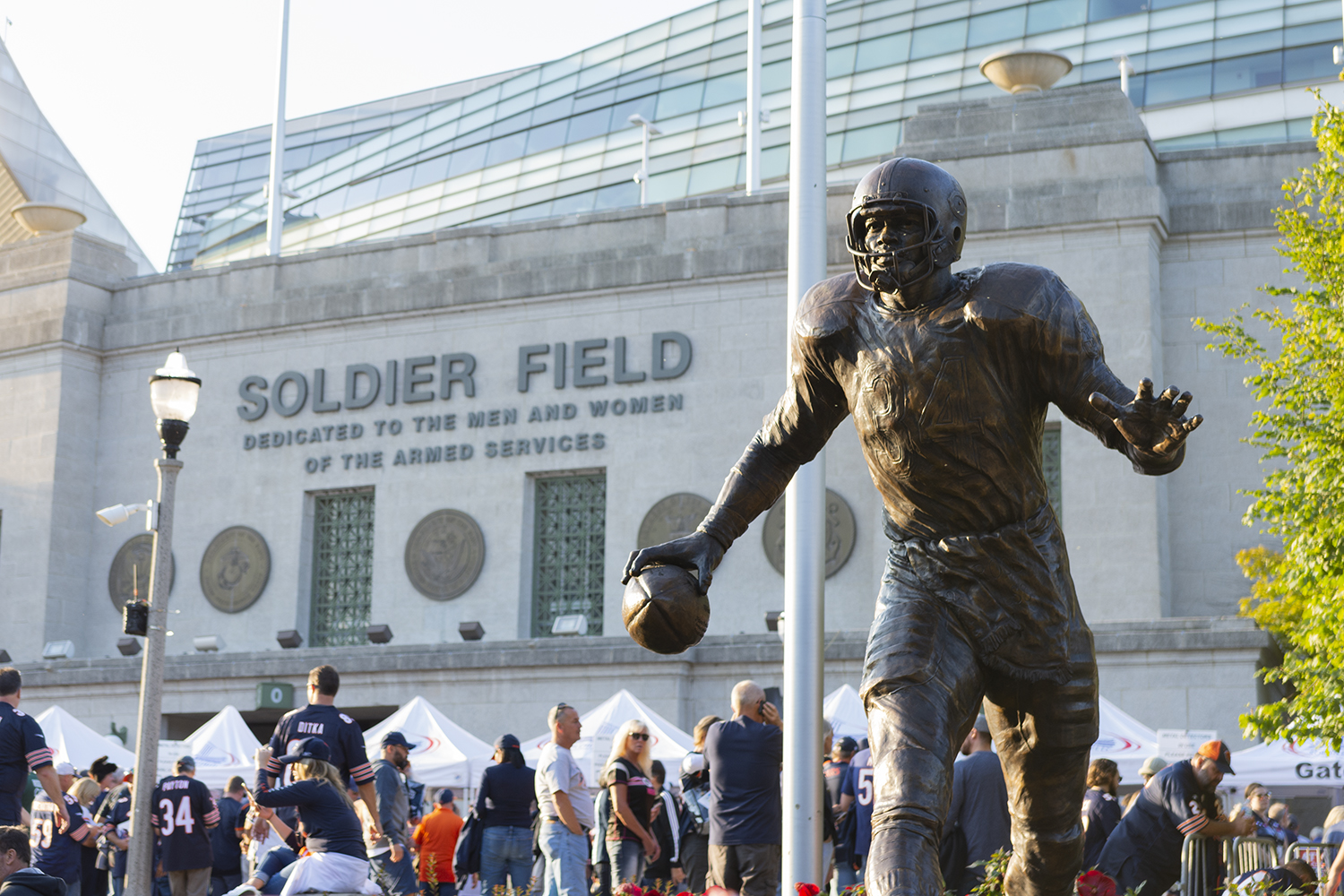 Fans+of+all+ages+gathered+around+the+Walter+Payton+statue+to+take+photos.