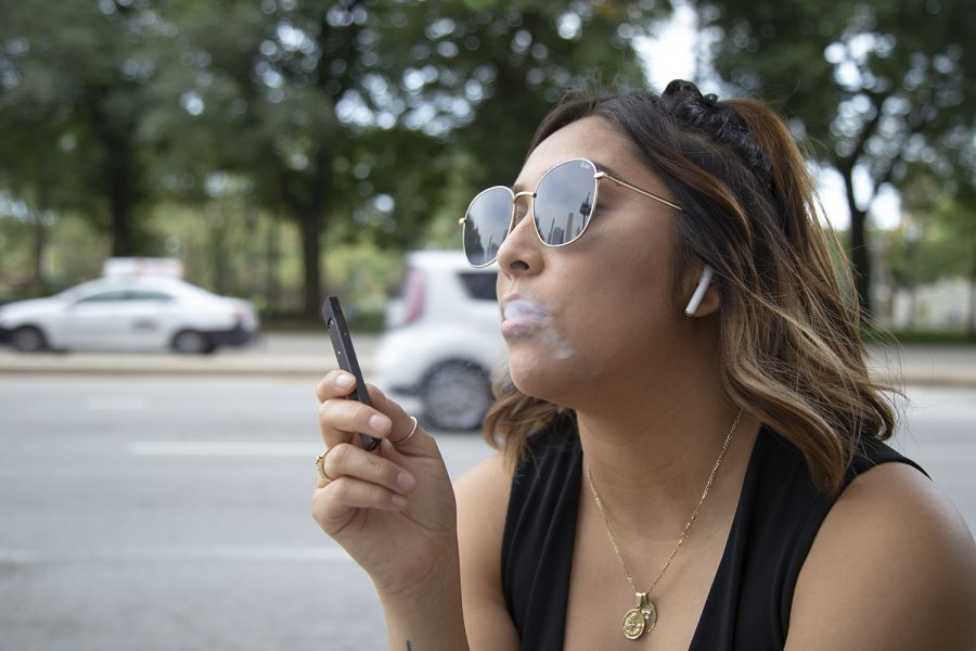 Fabiola Hernandez, junior fashion business major, smoking a JUUL outside Columbia's Library, 624 S. Michigan Ave., Sept. 10.