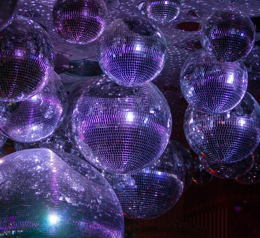 The disco ball chandeliers and dazzling lights adorn the inside of Lips Drag Queen Show Palace.