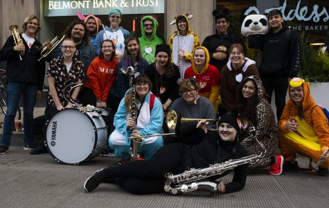 The Renegades Marching Band poses for a photo before performing at their first ever city parade during Arts in the Dark Oct. 19.