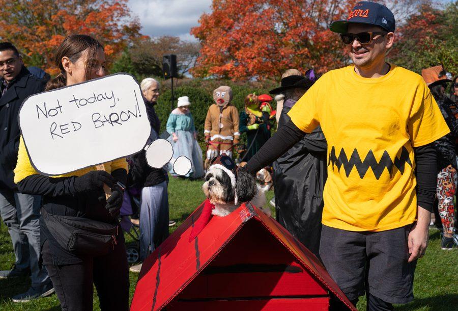 Natalie Battaglia and Dino Northway, dressed as Charlie Brown, and their dog Roy, dressed as Snoopy, attend the event wearing matching Peanuts costumes.