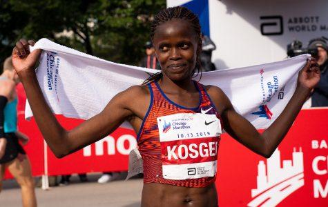 Brigid Kosgei, 25, poses after breaking the women's marathon world record at the 2019 Chicago Marathon Oct. 13.