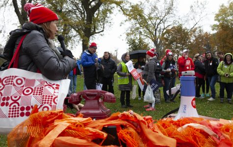 Eleuterio welcomes marchers to Calumet Park in Chicago, Oct. 26.