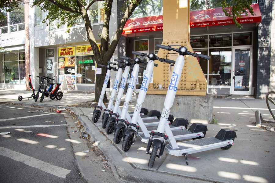 On Chicago's West Side, shareable e-scooters, or electric scooters, can be found lined up in neat rows near CTA stations.
