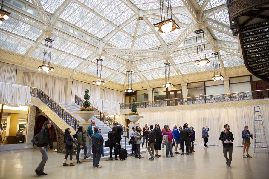 Attendees wander through the tourist viewing area of the Rookery Building, 209 S. LaSalle St.