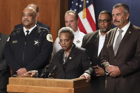 Mayor Lori Lightfoot (center) announced Friday that former chief of the Los Angeles Police Department Charlie Beck (right) would take over as police superintendent following the retirement of Eddie Johnson (left).