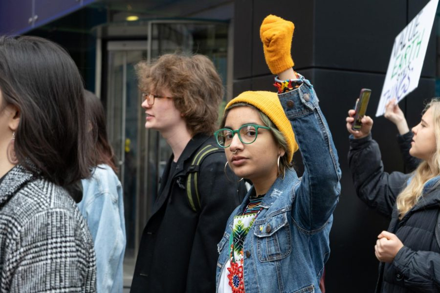 Maria Tirado, a community organizer at Greenpeace, attends the strike where she gives a speech at Chicago Water Tower, 806 Michigan Ave.