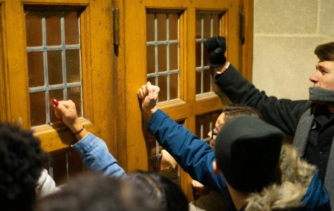 Protestors banged on the doors in order to disrupt former Attorney General Jeff Sessions' remarks on Northwestern University's campus Tuesday, Nov. 5.