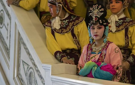 Members of the Zhejiang Shaoju Opera Theatre troupe wait to perform the