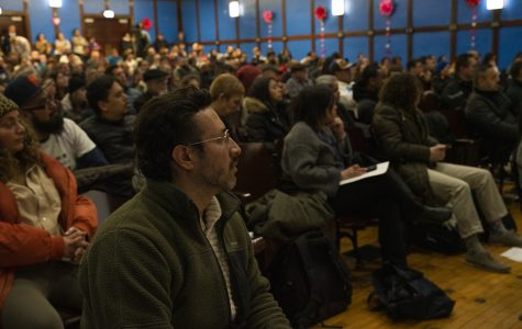 Attendees pack the auditorium of Pickard Elementary, at 2301 W. 21st Place, to hear community organizers and elected representatives address the issue of gun violence in the 25th ward.