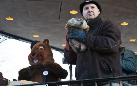 Mark Szafaran holds Woodstock Willie, who has played a part in the town's Groundhog Day celebration since the former mayor, Bill Anderson, requested a groundhog be present in 1997, the same year the groundhog costume was introduced.