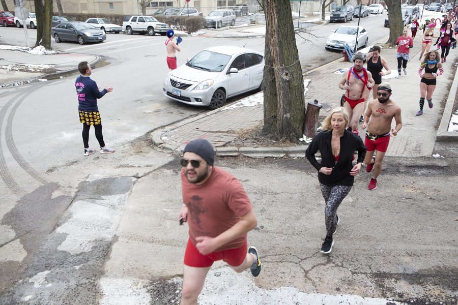Participants make their way through the last leg of the race before reaching the corner of  West Eddy Street and North Clark Street, the location of the finish line.