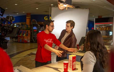 Miguel Garcia (left) gives directions to Brian Healy and Rachel Kim during the commercial shoot.
