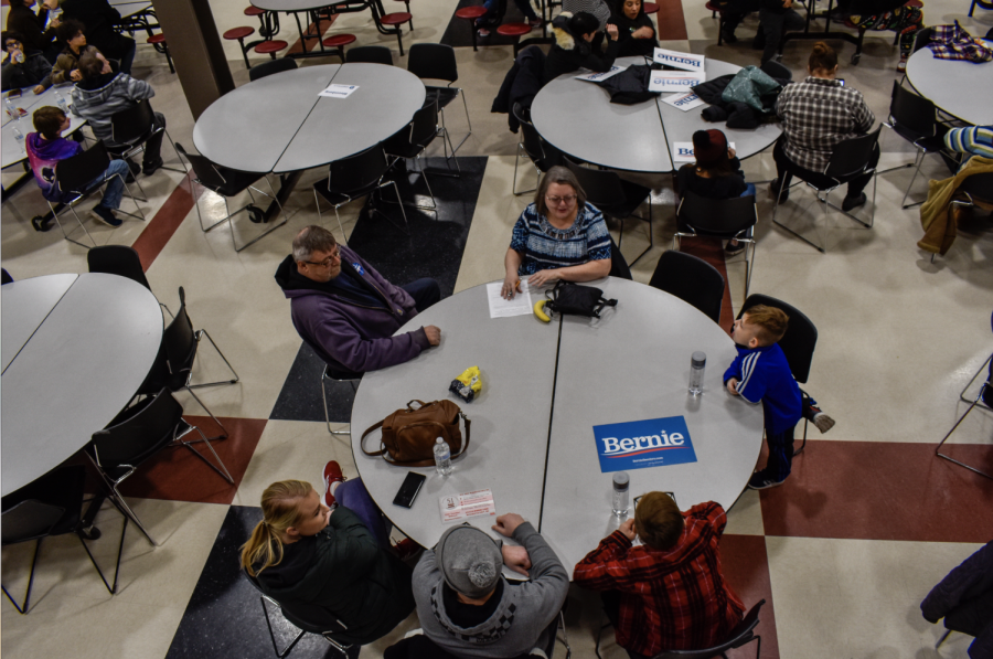 Iowan Caucus goers of the 33rd precinct gather in the cafeteria of East High School in Des Moines, Iowa, on Feb. 3, 2020. Bernie Sanders came away with three delegates from the precinct, Joe Biden with two, and Pete Buttigieg with one.