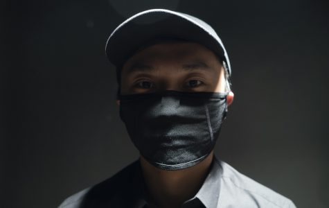 M.H. is organizing thousands of supplies, including medical masks similar to the one he is wearing, to be shipped to Hong Kong in the midst of surging prices due to the high demand.