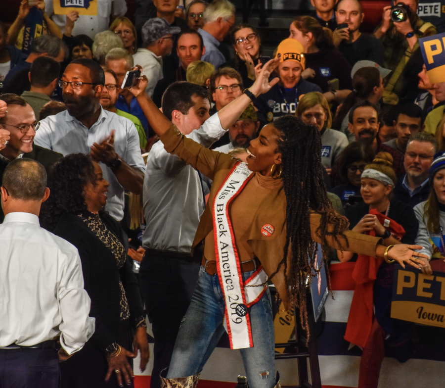 Ryann Richardson, Miss Black America 2019, takes pictures with attendees at Democratic presidential candidate Pete Buttigieg's rally at Lincoln High School in Des Moines, Iowa. Richardson, a native of Washington, D.C., announced her endorsement of Buttigieg in January 2020 in an opinion piece for the Grio.