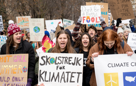 Activists march from Millennium Park to Federal Plaza during a Saturday, Dec. 7, 2019 climate strike led by Illinois Youth Climate Strike and the Sunrise Movement.