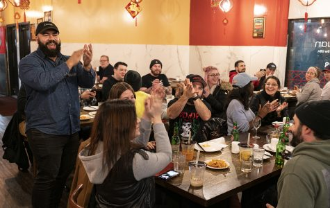 Carlos Matias leads a round of applause in Lao Sze Chuan to celebrate the restaurant bar crawl.