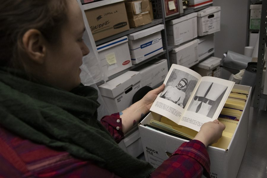 Mel Leverich, a museum archivist, reads through a BDSM mail order catalog in the archives.