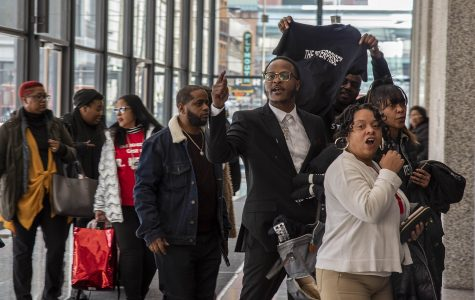 Defenders of R&B musician R. Kelly show their support for him after his hearing at the Dirksen Federal Building in downtown Chicago, Thursday, March 5.