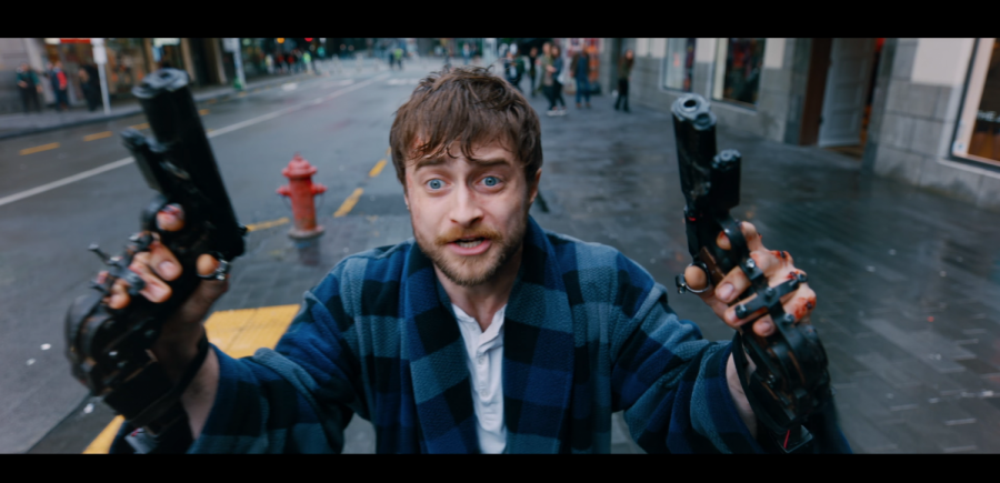 Miles, played by Daniel Radcliffe, desperately calls for help from two police officers in a still from the film.