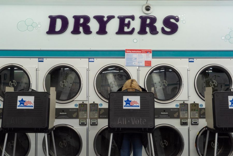 A voter at Su Nueva Chicago Laundromat in West Lawn casts a ballot in the Tuesday, March 17 Illinois primary.