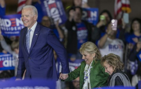 Democratic presidential candidate former Vice President Joe Biden arrives with wife Jill (center) and sister Valerie at a Super Tuesday campaign event at Baldwin Hills Recreation Center on March 3, 2020, in Los Angeles, California. After his make-or-break victory in South Carolina, Biden's momentum continued in the Super Tuesday primaries.