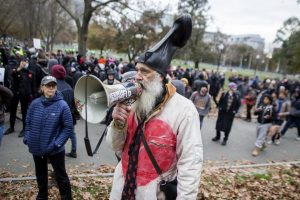 Vermin Supreme has been campaigning for the presidency with the Libertarian Party since 2012. He is known for wearing a rubber boot on his head and his free pony policy.