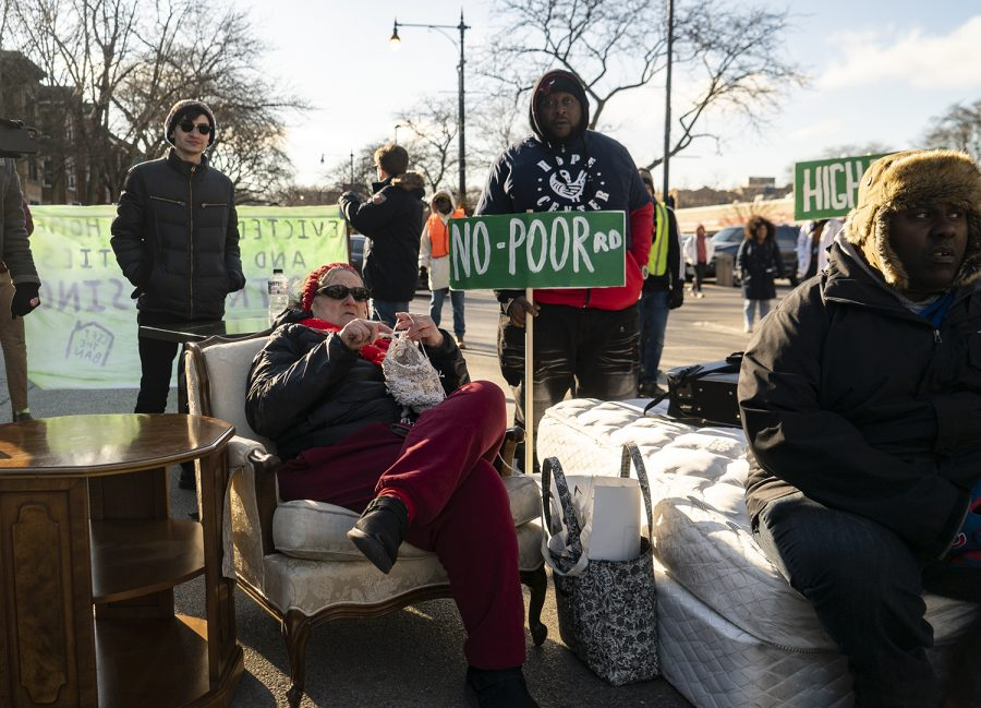 Tenants block off 53rd street by setting up furniture to mimic displacement from a single family home in Hyde Park.