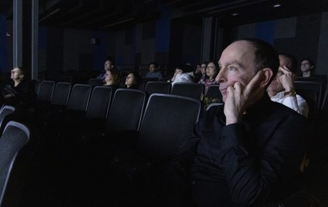 "Todd Burbank—a friend of Elio Leturia, an associate professor in the Communication Department— watches Fuentes' short film ""Selfie,"" in the audience as part of the Spain On Campus speaker series."