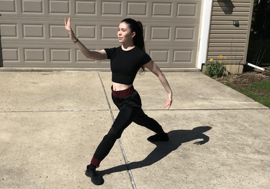 Junior dance major Audrey Hartnett practices for her dance courses in the driveway for enough space to move around.