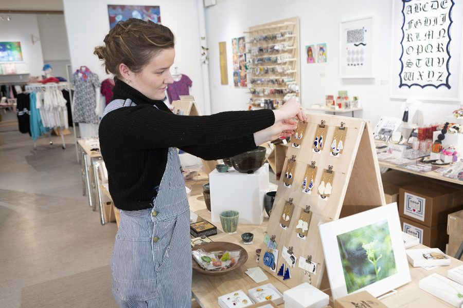 Freshman arts management major Emma Ivy finds time to make music, work at Shop Columbia and create her own earring business while taking 18 course credits.