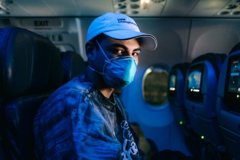 Nicolas Gil, a sophomore Ventura College philosophy major, wears a respirator during the four and a half hours flight to Los Angeles.