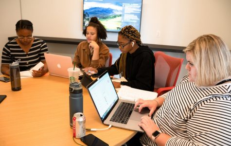 (Right) Newly election SGA President Anna Baumeister, a sophomore comedy writing and performance major, at a meeting with the 2019–2020 executive board.