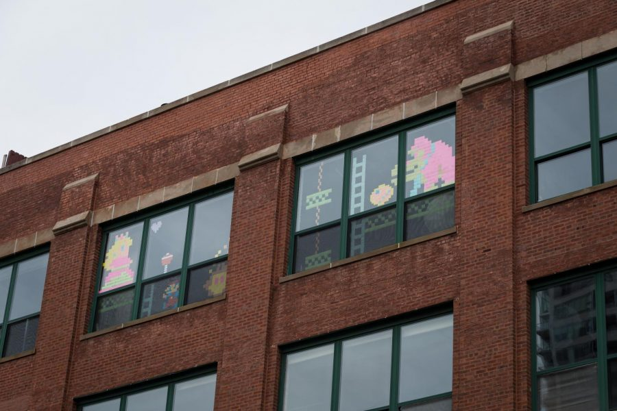 Some South Loop residents have been putting up sticky note designs on their windows for community support and fun amid the stay-at-home mandate.