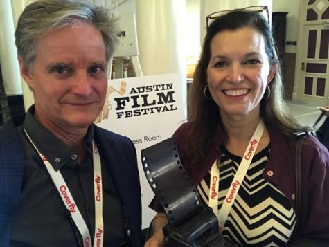 "Producer Ted Hardin (left) and co-director Elizabeth Coffman (right) hold their winning trophy for ""Flannery"" at the Austin Film Festival."