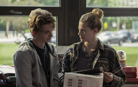 Austin Abrams' character, Henry Page, and Lili Reinhart's character, Grace Town, are introduced by collaborating on their high school's newspaper.