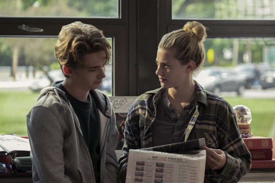 Austin Abrams character, Henry Page, and Lili Reinharts character, Grace Town, are introduced by collaborating on their high schools newspaper.
