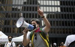 Protesters congregated at Federal Plaza on South Dearborn Street to hold a rally about the recently postponed