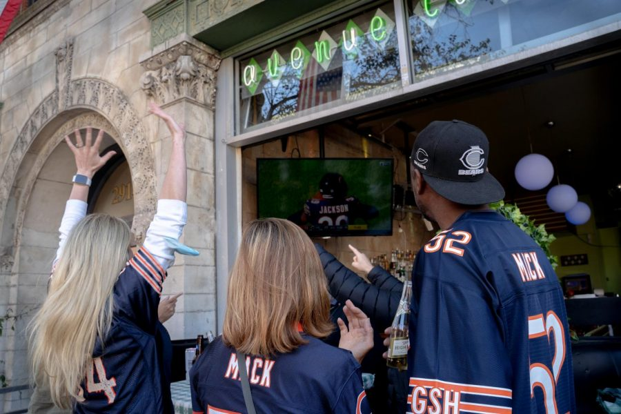 Katherine Bauer-Drozdzik (left) cheers for the Chicago Bears as they finish off the New York Giants on their last defensive play to win their home opener.