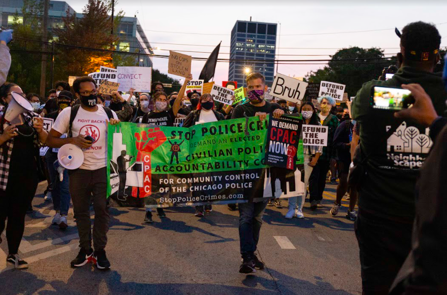 Protesters begin marching east on East 35th Street led by the Chicago Alliance Against Racist and Political Repression and demanding a CPAC, or Civilian Police Accountability Council.