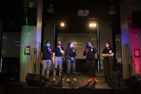 Founding members Tandrea Hawkins and Jordan Blair stand on stage with other Fusion of Light Entertainment organizers Dupree, Liam Taylor and Sofia Felino.