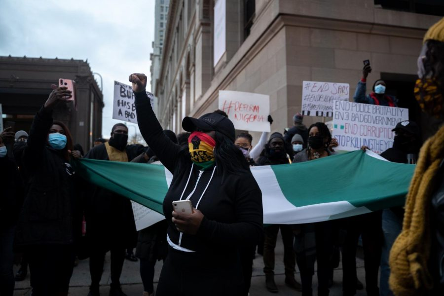 Protesters march toward Michigan Avenue on Oct. 24 to bring awareness to issues with SARS in Nigeria, after forces opened fire on protesters in Nigeria on Oct. 20.