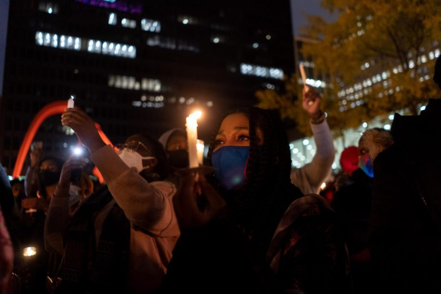 Temitope Odedoyin participates in the candlelight vigil at Federal Plaza after the prayer walk for Nigeria.