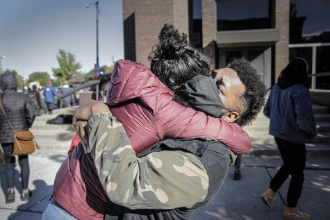 """Jeremy """"Mohawk"""" Johnson embraces protesters after receiving a court date scheduled for Oct. 14."""