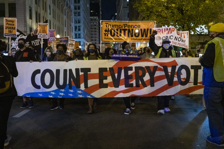 After a series of speakers from organizations across the city addressed the motivation for the rally, demonstrators made their way onto North Dearborn Street, walking toward Trump Tower.