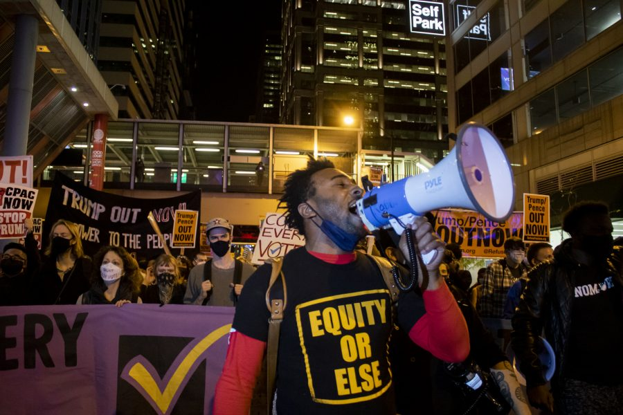 """Troy Gaston marches with protesters shouting """"say their names"""" in solidarity with Black lives lost to police brutality."""